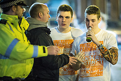 "© Licensed to London News Pictures . 15/11/2015 . Manchester , UK . A police officer alcohol from people drinking in the street . Annual student pub crawl "" Carnage "" at Manchester's Deansgate Locks nightclubs venue . The event sees students visit several clubs over the course of an evening . This year's theme is "" Animal Instinct - unleash your beast "" . Photo credit : Joel Goodman/LNP"