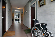 hallway and entrance to apartment in an independent living complex for the elderly