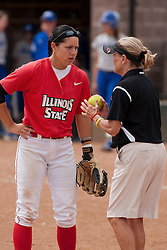 15 April 2012:  Elizabeth Kay gets instructions from coach Melinda Fischer during an NCAA women's softball game between the Drake Bulldogs and the Illinois State Redbirds on Marian Kneer Field in Normal IL