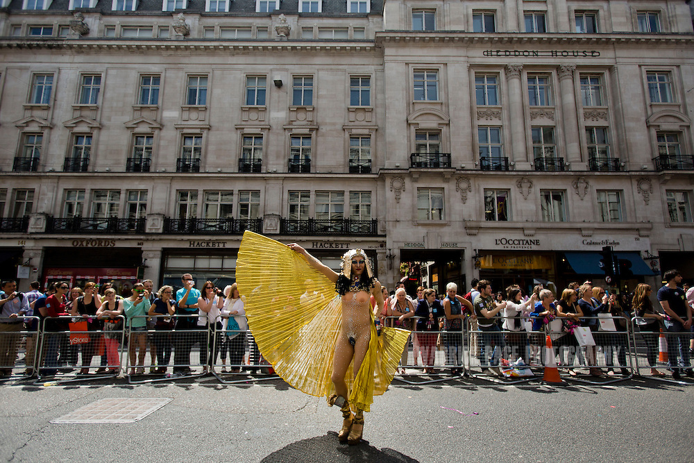 LONDON, UNITED KINGDOM - JUNE 29: A members of the LGBT community performs for the crowd as he participates in the annual London Pride Parade, on June 29, 2013, in London, Untied Kingdom. The Pride Parade originated in 1971, with this years theme being Love (and marriage), due the increased social and political pressure to make gay marriage law in the UK and several other countries throughout the world. (Photo by Warrick Page)