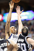 Dallas Mavericks small forward Shawn Marion (0) shoots the ball over San Antonio Spurs shooting guard Manu Ginobili (20) at American Airlines Center in Dallas, Texas, on January 25, 2013.  (Stan Olszewski/The Dallas Morning News)