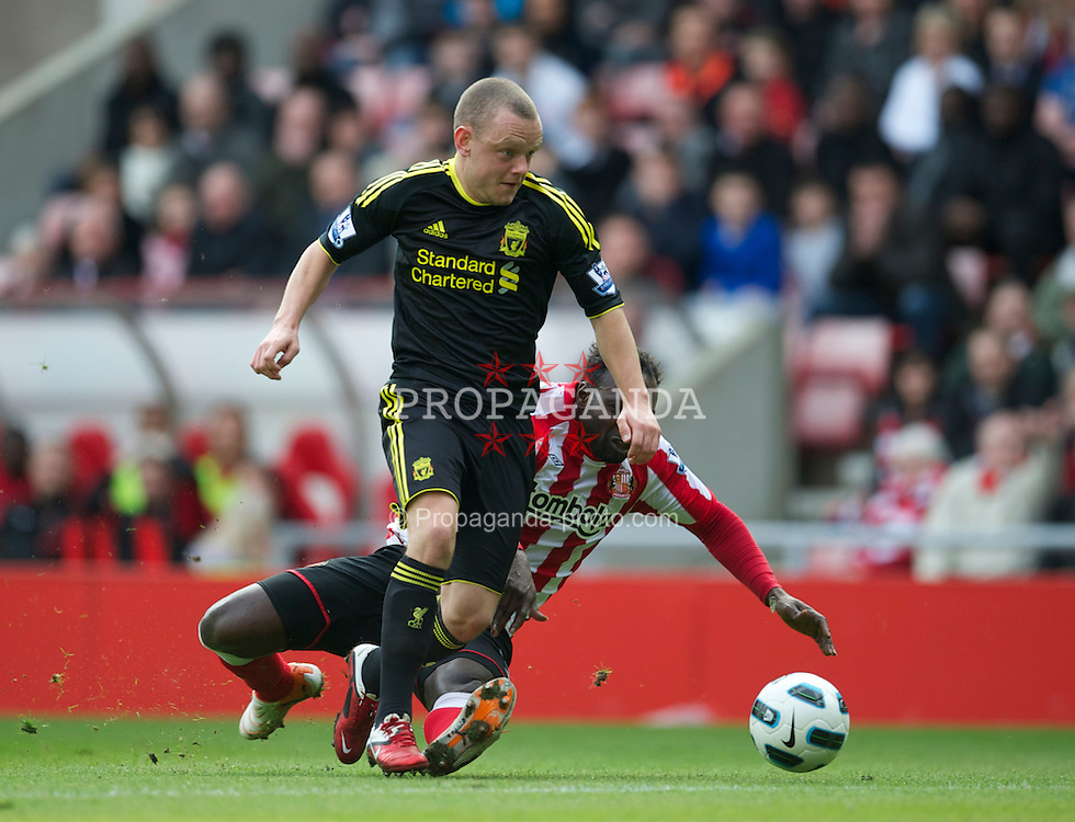 SUNDERLAND, ENGLAND - Sunday, March 20, 2011: Liverpool's Jay Spearing is brought down by Sunderland's John Mensah for a penalty during the Premiership match at the Stadium of Light. (Photo by David Rawcliffe/Propaganda)