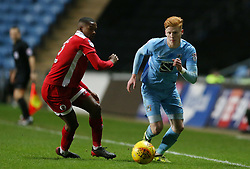 Coventry City's Ryan Haynes and Crawley Town's Lewis Young