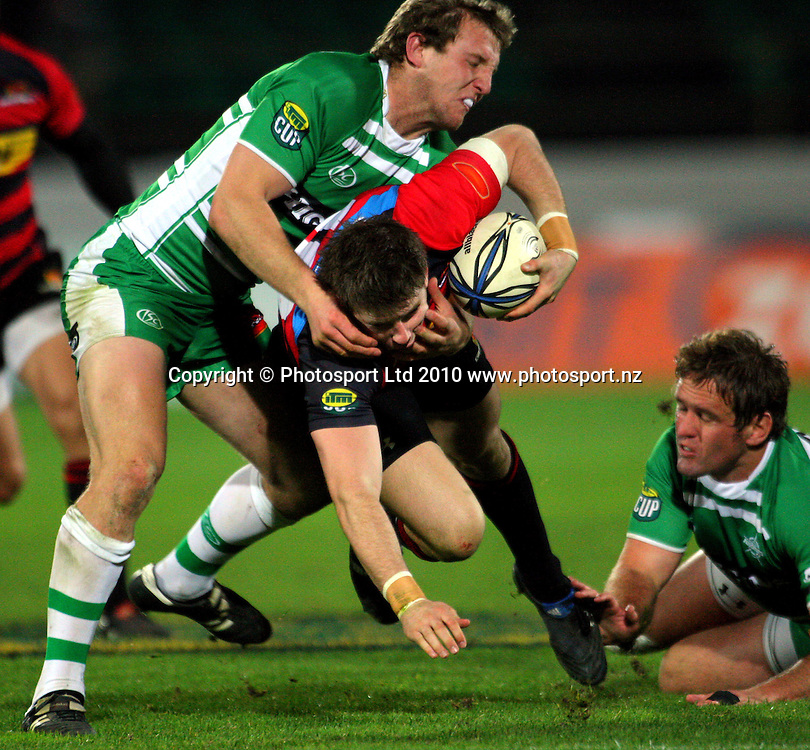 Manawatu's Hadleigh Parkes tackles Colin Slade. ITM Cup rugby - Manawatu Turbos v Canterbury at FMG Stadium, Palmerston North, New Zealand on Friday, 5 August 2010. Photo: Dave Lintott/Photosport