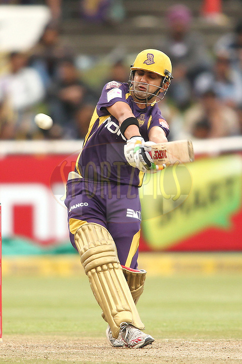 Kolkata Knight Riders captain Gautam Gambhir pulls a delivery to the boundary during match 16 of the Karbonn Smart CLT20 South Africa between The Kolkata Knight Riders and the Titans held at Newlands Stadium in Cape Town, South Africa on the 21st October 2012..Photo by Shaun Roy/SPORTZPICS/CLT20