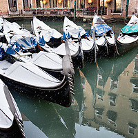 VENICE, ITALY - DECEMBER 17: Gondolas covered with snow rest in Bacino Orseolo on December 17, 2010 in Venice, Italy. Snow has fallen across much of Europe today and is expected to continue over the weekend, causing traffic chaos and disrupting Christmas deliveries. San Marco is one of the six sestieri of Venice, lying in the heart of the city.