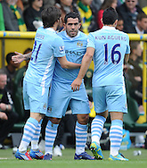 Picture by Andrew Timms/Focus Images Ltd. 07917 236526.14/04/12.Carlos Tevez, David Silva & Sergio Aguero of Manchester City celebrate Man City's first goal during the Barclays Premier League match against Norwich City at Carrow Road stadium, Norwich.
