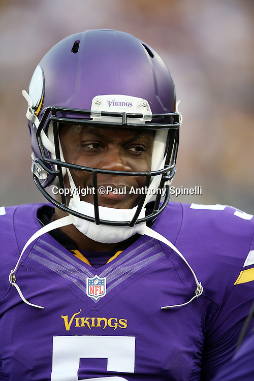Minnesota Vikings quarterback Teddy Bridgewater (5) smiles during pregame warmups before the 2015 NFL Pro Football Hall of Fame preseason football game against the Pittsburgh Steelers on Sunday, Aug. 9, 2015 in Canton, Ohio. The Vikings won the game 14-3. (©Paul Anthony Spinelli)