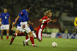 BELGRADE, SERBIA & MONTENEGRO - Wednesday, August 20, 2003: Wales' Robbie Savage and Serbia & Montenegro's Goran Gavrancic during the UEFA European Championship qualifying match at the Red Star Stadium. (Pic by David Rawcliffe/Propaganda)