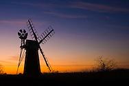 Silhouette of windpump at dusk, Turf Fen Windpump, River Ant, Ludham, The Broads N.P., Norfolk, England