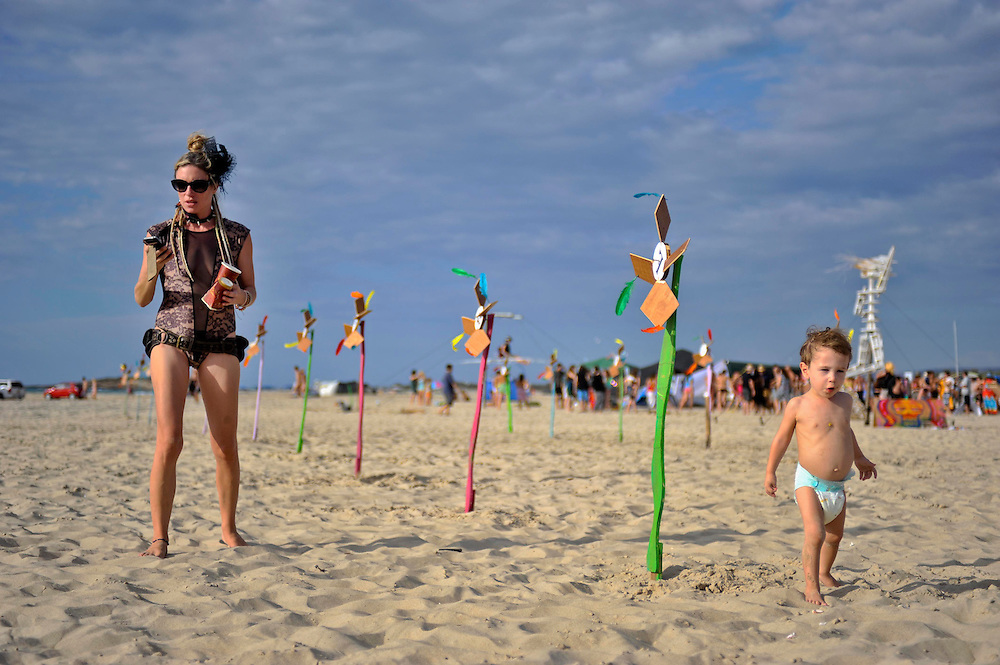 "Participant and her baby boy at ""Mid Burn"", the Israeli ""Burning Man Festival"" held at ""Habonim"" beach north of Israel October 4-6, 2012."