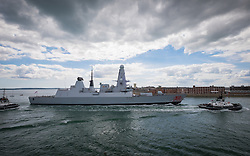 © Licensed to London News Pictures. 26/04/2016. Portsmouth, United Kingdom. The Royal Naval Destroyer, HMS Dragon, returning into Portsmouth Harbour this afternoon, 14th July 2016, following intensive sea trials in UK Waters. The Type-45 Destroyer has recently undergone a major upgrade and refurbishment, and is now undergoing intensive sea trials before being deployed overseas in her third deployment. HMS Dragon has also had a fresh coat of paint, including a facelift for the well-known decorative red Welsh dragon on her bow. Photo credit: Rob Arnold/LNP
