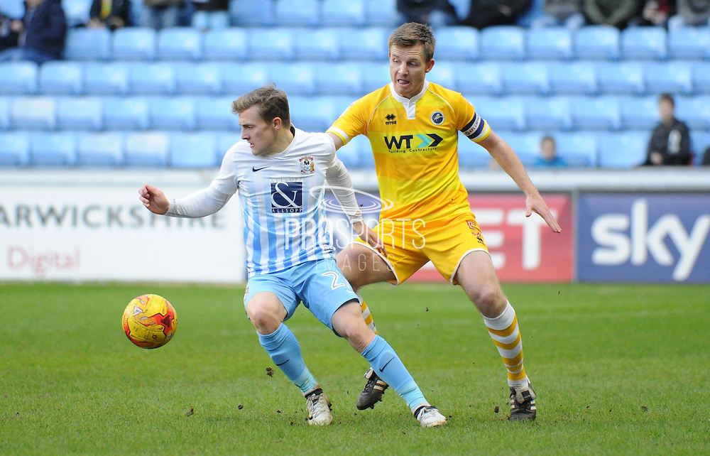 George Thomas of Coventry City (27) turns away from Tony Craig of Millwall (5) during the EFL Sky Bet League 1 match between Coventry City and Millwall at the Ricoh Arena, Coventry, England on 4 February 2017. Photo by Andy Handley.