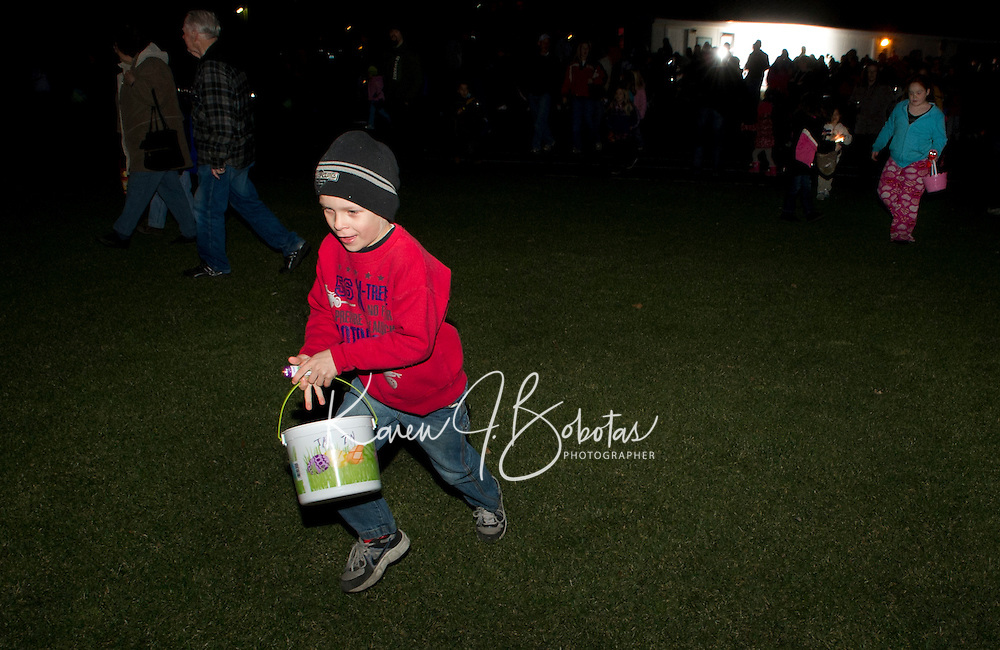 Laconia Parks and Recreation flashlight Easter Egg hunt at Smith Track in Opechee Park March 31, 2012.