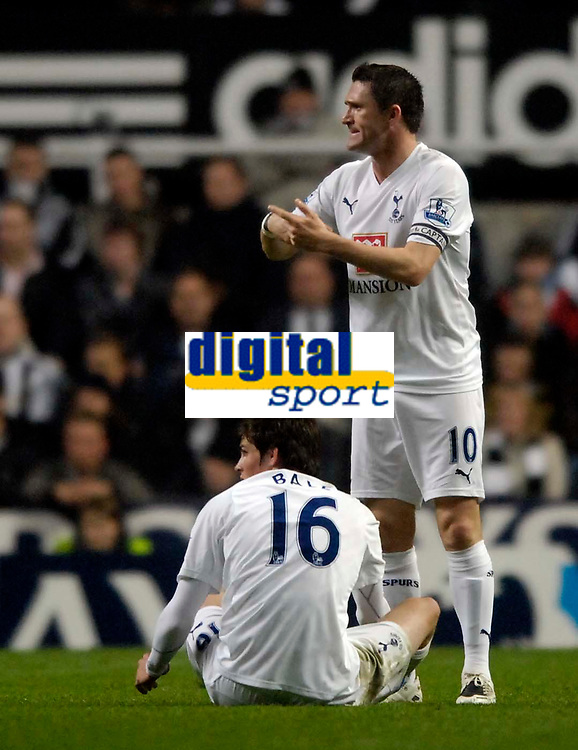 Photo: Jed Wee/Sportsbeat Images.<br /> Newcastle United v Tottenham Hotspur. The FA Barclays Premiership. 22/10/2007.<br /> <br /> Tottenham captain Robbie Keane (R) signals for the substitution as team mate Gareth Bale is stricken by injury.