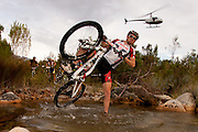 Lukas Fluckiger attempts to encourage his TREK bicycle to continue through a river crossing during stage 3 of the 2011 Absa Cape Epic Mountain Bike stage race held from Saronsberg Wine Estate in Tulbagh to Worcester Gymnasium in Worcester, South Africa on the 30 March 2011..Photo by Greg Beadle/Cape Epic/SPORTZPICS