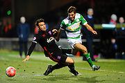 Carlisle Utd's David Atkinson tackles Yeovil Town's Ryan Dickson during the The FA Cup Third Round Replay match between Yeovil Town and Carlisle United at Huish Park, Yeovil, England on 19 January 2016. Photo by Graham Hunt.