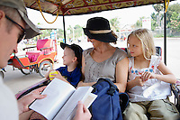 Family Riding in Rickshaw