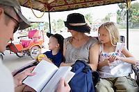 Family Riding in Rickshaw