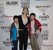 Fashion designer June Sohn and family at Nolcha Fashion Week New York Fall-Winter 2014. Nolcha Fashion Week New York is a leading award winning event, held during New York Fashion Week, for independent fashion designers to showcase their collections to a global audience of press, retailers, stylists and industry influencers. Over the past six years Nolcha Fashion Week: New York has established itself as a platform of discovery promoting innovative fashion designers through runway shows and exhibition. Nolcha Fashion Week: New York has built an acclaimed reputation as a hot incubator of new fashion design talent and is officially listed by New York City Economic Development Corporation; offering a range of cost effective options to increase designers recognition and develop their business. (Photo: www.JeffreyHolmes.com)