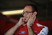 April 19-21, 2013- Ducati team member holds his ears while a bike warms up...