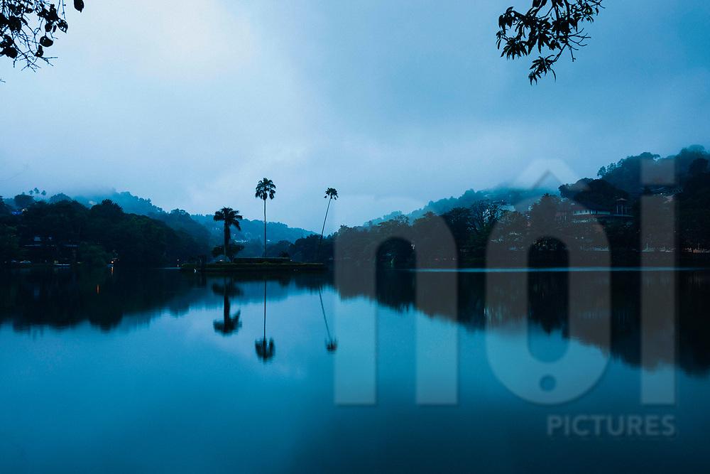 Early morning reflections in Bogambara Lake, Kandy, Sri Lanka, Asia