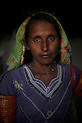 A portrait of Lashmi Bheel, age 30, who was enslaved for 4 years.<br /> <br /> Following the release of the Global Slavery Index by the Walk Free Foundation Pakistan is ranked 3rd worse in the world behind India and China. The Asian Development Bank estimates some 1.8 million people are slaves in Pakistan yet other estimates reach up to 4 million people, most of which toil year after year in brick kilns or sugar cane plantations. Their stories are the same; they have no-where to turn so they borrow money from a land-owner for a medical emergency or marriage dowry. The landlords pay in return for work, their labour supposed to be taken off the amount borrowed. Yet after years of no salary incredibly their amount owed is often quadrupled, the excuse being the amount they cost to feed! Many are chained, abused, raped and even killed.<br /> <br /> For years they had no where to run, no one to help but now a small local NGO called the Green Development Rural Organisation (GDRO) works to free bonded-slaves by using the law against their captives. Yet, often freed slaves end up right back where they were or risk being hunted by the landowner and forced to return. So GRDO started building villages so slaves who escape or are freed have somewhere safe to go. It now has two, whose names translate from Urdu as 'Village of the Freed' and 'Village of the Courageous', and is working on a 3rd. The land is bought and allocated to freed slave families where they can built a house and start again. Without such help the vicious cycle would continue.