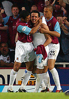 Photo: Daniel Hambury, Digitalsport<br /> NORWAY ONLY<br /> <br /> West Ham United V Ipswich Town<br /> Nationwide League  Division One Play Off Semi Final  Second Leg<br /> 18/5/2004.  <br /> <br /> West Ham's Matthew Etherington celebrates his goal with team mates Bobby Zamora (r/h/s) and Hayden Mullins