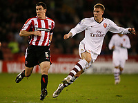 Photo: Steve Bond.<br /> Sheffield United v Arsenal. Carling Cup. 31/10/2007. Nicklas Bendtner (R) shoots as Chris Morgan (L) tries to get close