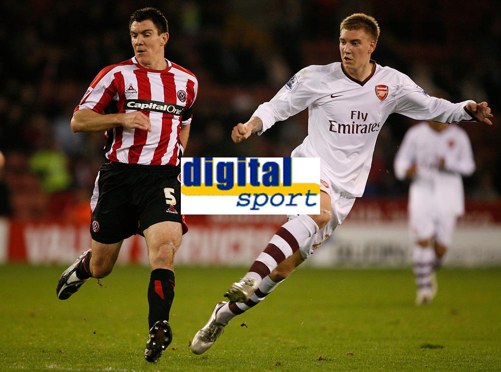 Photo: Steve Bond.<br /> Sheffield United v Arsenal. Carling Cup. 31/10/2007. Nicklas Bendtner (R) shoots as Chris Morgan (L) tries to get close