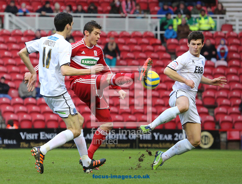 Picture by Paul Gaythorpe/Focus Images Ltd +447771 871632.26/01/2013.Lukas Jutkiewicz of Middlesbrough and Peter Vincenti and Aaron Morris of Aldershot Town during the FA Cup match at the Riverside Stadium, Middlesbrough.