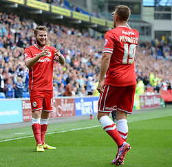 Cardiff City's Aron Gunnarsson celebrates his goal with Cardiff City's Anthony Pilkington - Photo mandatory by-line: Alex James/JMP - Mobile: 07966 386802 30/08/2014 - SPORT - FOOTBALL - Cardiff - Cardiff City stadium - Cardiff City  v Norwich City - Barclays Premier League