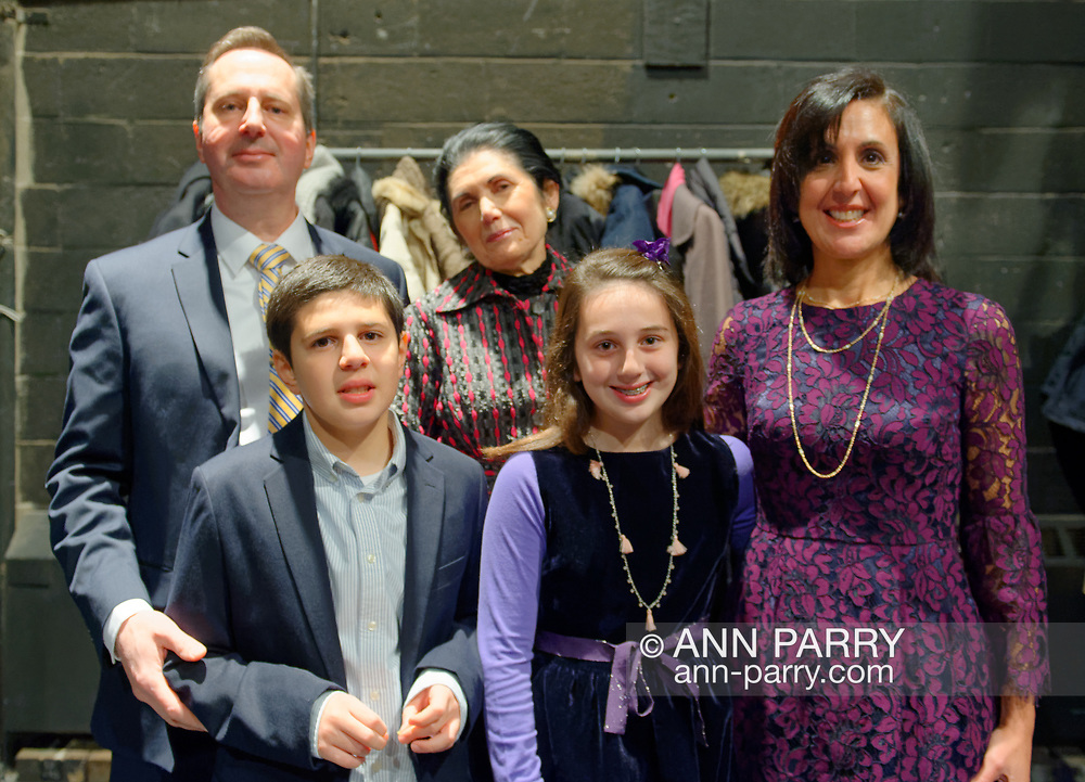 Hempstead, New York, USA. January 1, 2018. Hempstead Town Clerk SYLVIA CABANA poses with her family - husband, son, daughter, and mother - shortly before start of Swearing-in ceremony at Hofstra University.