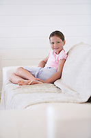 Girl Sitting on Sofa