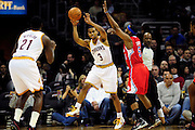 Feb. 11, 2011; Cleveland, OH, USA; Cleveland Cavaliers point guard Ramon Sessions (3) passes to power forward J.J. Hickson (21) under pressure from Los Angeles Clippers point guard Baron Davis (5) during the first quarter at Quicken Loans Arena. Mandatory Credit: Jason Miller-US PRESSWIRE