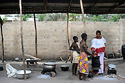 A family cooking in their kitchen outside their home in Cotonou, Benin on February 29, 2008.