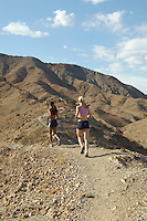 Two women jogging in mountains