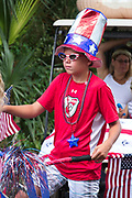A young boy dressed in patriotic colors during the annual Sullivan's Island Independence Day parade July 4, 2017 in Sullivan's Island, South Carolina. The tiny affluent sea island hosts a bicycle and golf cart parade through the historic village.