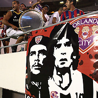 Orlando City soccer fans play musical instruments during a United Soccer League Pro soccer match between the Wilmington Hammerheads and the Orlando City Lions at the Florida Citrus Bowl on June 18, 2011 in Orlando, Florida.  (AP Photo/Alex Menendez)