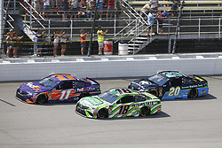 August 12, 2018 - Brooklyn, Michigan, United States of America - Denny Hamlin (11), Kyle Busch (18) and Erik Jones (20) battle for position during the Consumers Energy 400 at Michigan International Speedway in Brooklyn, Michigan. (Credit Image: © Chris Owens Asp Inc/ASP via ZUMA Wire)