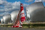 CAMPER with Emirates Team New Zealand sails up the Thames river to London for a media event at the London Design Museum. Passing through the Thames flood barrier. 5/9/2011