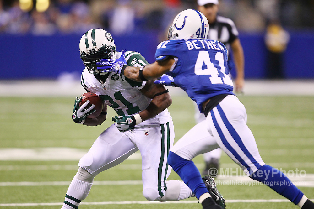 Jan. 08, 2011; Indianapolis, IN, USA; New York Jets running back LaDainian Tomlinson (21) takes a hand to the face from Indianapolis Colts safety Antoine Bethea (41) during the 2011 AFC wild card playoff at Lucas Oil Stadium. Mandatory credit: Michael Hickey-US PRESSWIRE