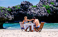 Honeymoon couple a picnic lunch on a deserted island (Nooki Nooki Island) near Vatulele Island Resort, Fiji Islands