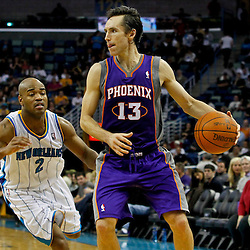 February 2, 2012; New Orleans, LA, USA; Phoenix Suns point guard Steve Nash (13) is guarded by New Orleans Hornets point guard Jarrett Jack (2) during the second half of a game at the New Orleans Arena. The Suns defeated the Hornets 120-103.  Mandatory Credit: Derick E. Hingle-US PRESSWIRE