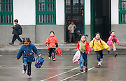 Children run through the playground of a primary school in Fuli. China has a one child policy to limit population.