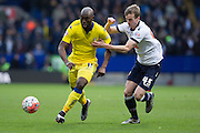 Souleymane Doukara of Leeds United under pressure from Bolton Wanderers defender Robert Holding during the during the The FA Cup fourth round match between Bolton Wanderers and Leeds United at the Macron Stadium, Bolton, England on 30 January 2016. Photo by Simon Brady.