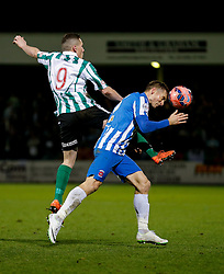 Neil Austin of Hartlepool United heads clear from Daniel Maguire of Blyth Spartans - Photo mandatory by-line: Rogan Thomson/JMP - 07966 386802 - 05/12/2014 - SPORT - FOOTBALL - Hartlepool, England - Victoria Park - Hartlepool United v Blyth Spartans - FA Cup Second Round Proper.