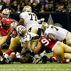 August 12, 2011; New Orleans, LA, USA; New Orleans Saints running back Pierre Thomas (23) dives forward for extra yardage during the first half of a preseason game at the Louisiana Superdome. Mandatory Credit: Derick E. Hingle