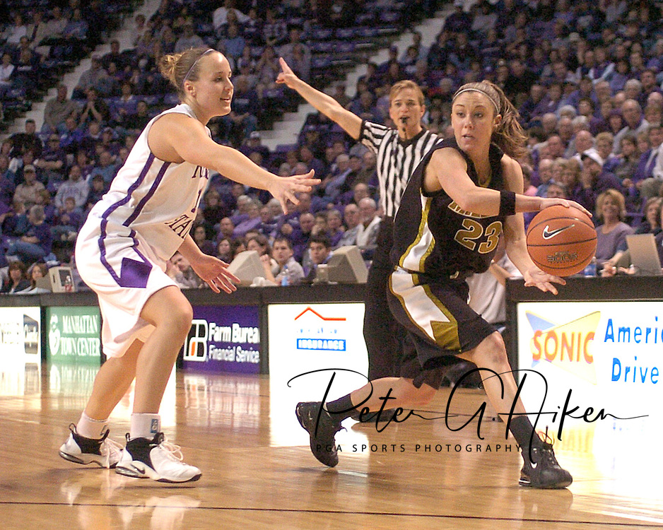 Missouri guard Blair Hardiek (23) looks to make a pass against pressure from Kansas State's Kimberly Dietz (13), during Missouri's 66-65 overtime win over K-State at Bramlage Coliseum in Manhattan, Kansas, February 1, 2006.