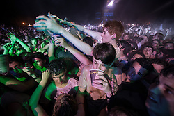 © Licensed to London News Pictures . 21/07/2013 . Suffolk , UK . A fan crowdsurfs . Foals play at the Obelisk Arena as the closing act on the festival's main stage . The Latitude music and culture festival in Henham Park , Southwold . Photo credit : Joel Goodman/LNP